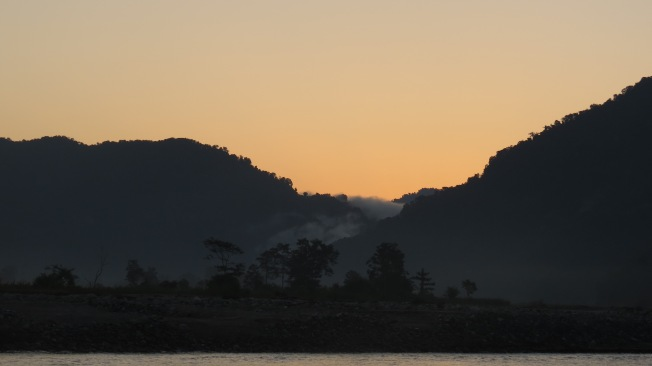 Mist rolling from bewteen mountains at dawn, Namdapha